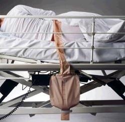Bolsa Alto Débito con paciente en cama